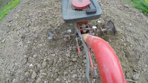 Closeup of hand motor plow blade throwing clay Footage