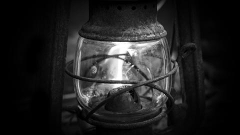 Old lantern on wooden background Photo