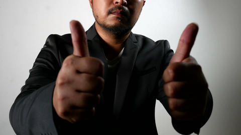 Hardwork sweating Serious Businessman in Black Suit showing thumbs up Live Action