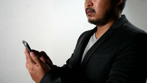 Serious Businessman man using smartphone Browsing and Text Messaging ビデオ