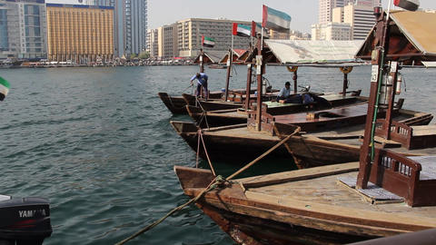 Several Abra boats parked side by side, traditional Dubai Creek ferry Live Action