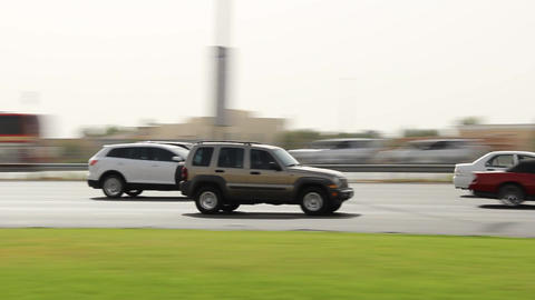 Tracking shot of Jeep rush along Sheikh Zayed highway, medium telephoto lens Footage