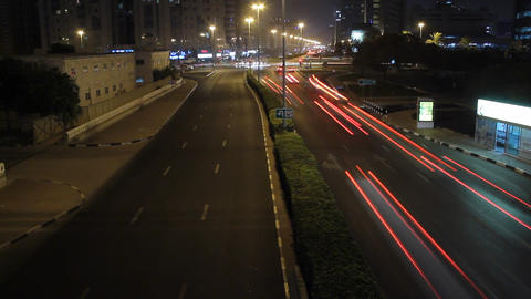 Flock of cars dash over night junction, time lapse from top perspective Footage