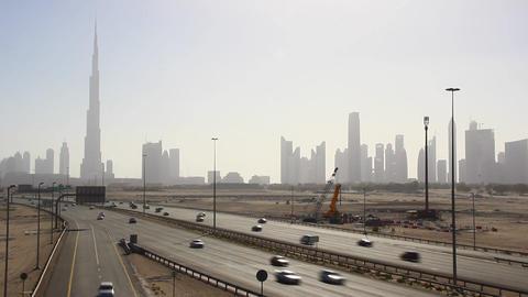 Dubai skyline from undeveloped desert side, skyscraper silhouettes in line Footage
