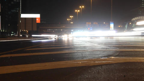 Headlamp beams of busy traffic at night highway, time lapse shot Footage