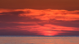Red Sunset above Sea Sun Disk Hides behind Horizon Footage