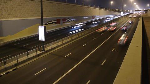 Quick traffic at city junction underpass way, time lapse perspective shot Footage