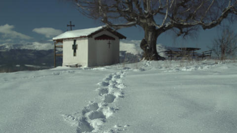 Footsteps in the Snow Mountain Church Panning 4K Footage