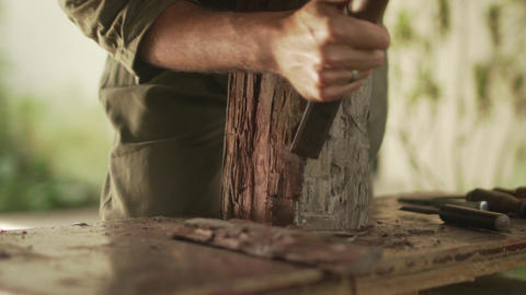 6 Sculptor Cleaning Working Desk From Wood And Chiseling Statue stock footage