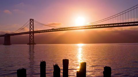 Sun Rises Behind The Bay Bridge Footage