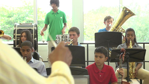 Pupils Playing Musical Instruments In School Orchestra Footage