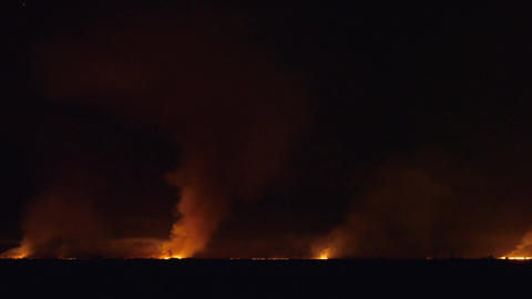 Pan Of Field Is On Fire At Night Footage