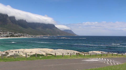 View of the coastline and famous Table Mountain in Cape Town, South Africa Live Action