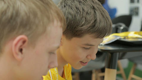 Side View Smart Schoolboys in Yellow Shirts Look and Talk Footage