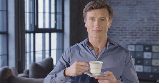 Slow Motion Portrait of Successful Businessman Drinking Tea Smiling. Businessman Live Action