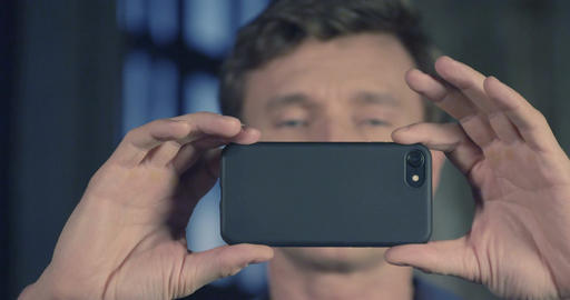 Slow Motion Portrait of Attractive Man Using Smartphone Camera Shooting at Studi Footage