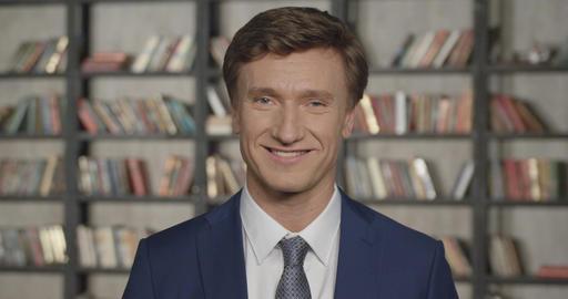 Slow Motion Portrait of Successful Confident Businessman at Office Smiling. Busi Live Action