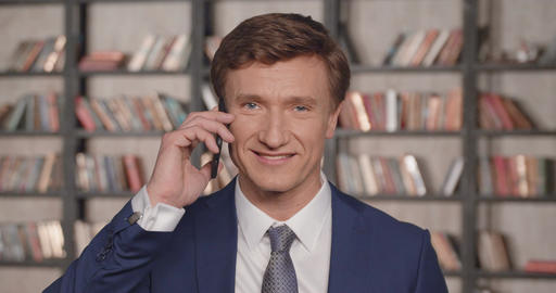 Slow Motion Portrait of Successful Confident Businessman Talking on the Phone at Footage