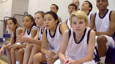 Slow Motion Shot Of Spectators At School Basketball Match Footage
