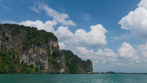 Tropical island, fluffy clouds, turquoise water at bright day timelapse Filmmaterial