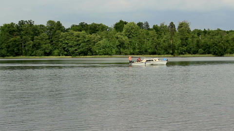 Motor boat passing through on the lake 2 Archivo