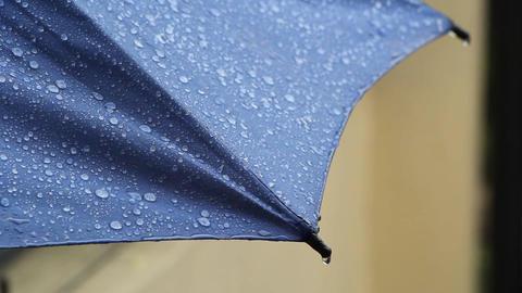 Rain Drops hitting a blue umbrella Footage