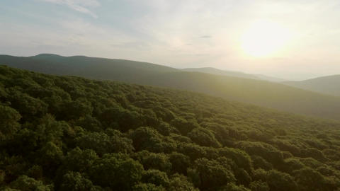Drone Flight Up Reveals Sun and Mountains Footage