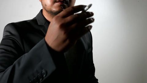 Serious Businessman in Black Suit smoking cigarette Footage