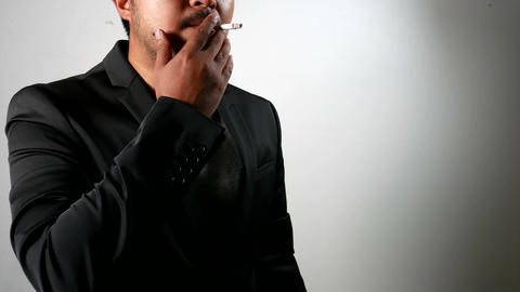 Serious Businessman in Black Suit smoking cigarette Footage