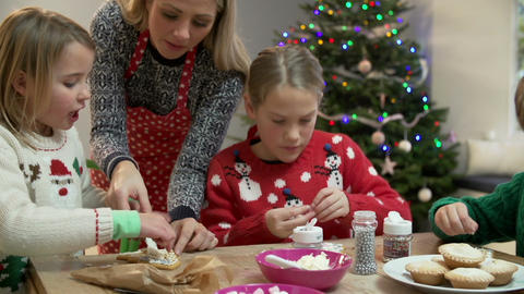 Mother And Children Decorating Christmas Cookies Together Footage