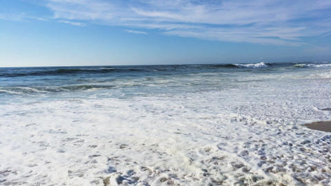 Waves Reaching Beach Shore at Low Angle Footage