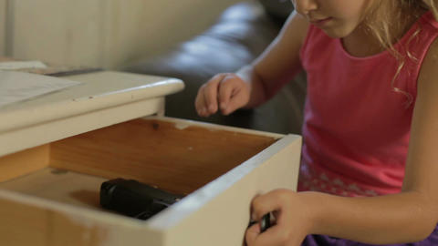Girl Playing With Parent's Gun She Has Found At Home Footage