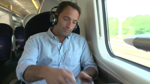 Man Listening To Music On Train Journey Footage