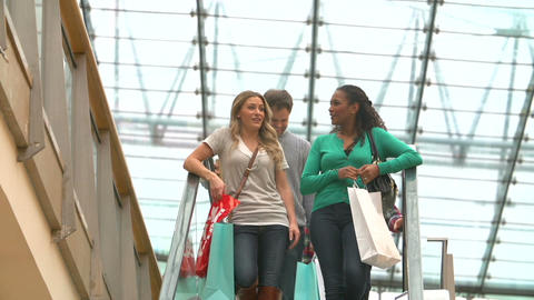 Two Female Friends On Escalator In Shopping Mall Footage