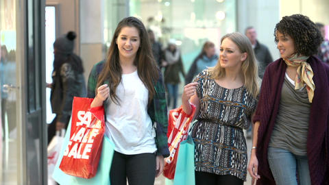 Three Female Friends Shopping In Mall Together Footage