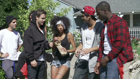Gang Of Young People In Urban Setting Drinking Alcohol Footage