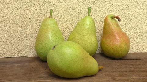 Fresh organic pears on wooden plank. Pears on wooden table Footage