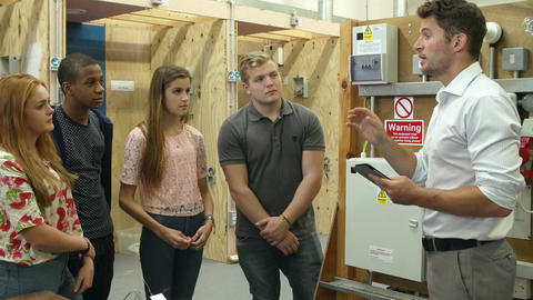 Teacher Helping Students Training To Be Electricians Live Action