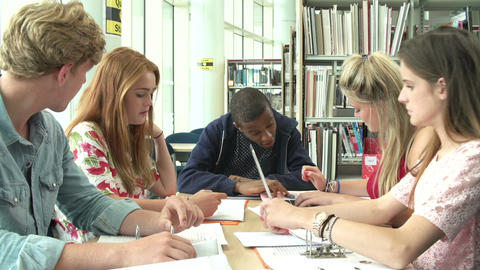 Group Of Students Working Together In Library With Teacher Footage