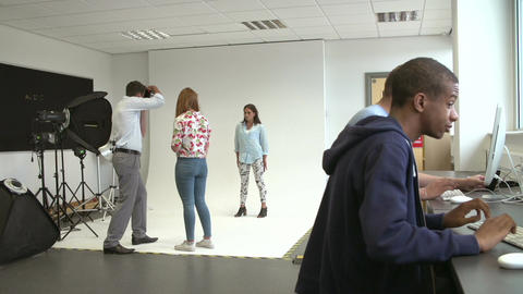 Teacher Helping College Students Studying Photography Footage