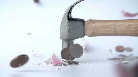 Hammer Smashing Piggy Bank In Slow Motion Footage
