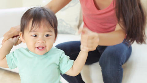 One Year Old Boy Taking First Steps With Mother Footage