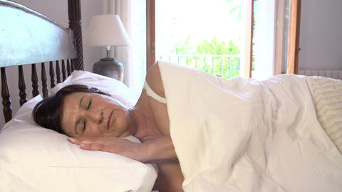 Mature Woman Sleeping In Bed During Day Footage