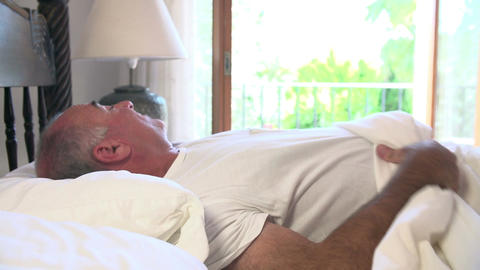 Mature Man Waking Up In Bed In Morning Footage