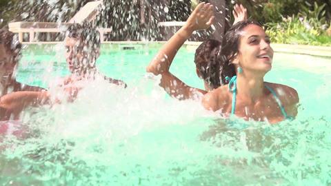 Teenage Friends Having Fun And Splashing In Swimming Pool Footage