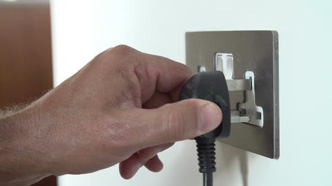 Slow Motion Shot Of Man Putting Plug Into Electrical Socket Live Action