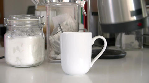 Close Up Shot Showing Water Being Poured To Make Cup Of Tea Footage