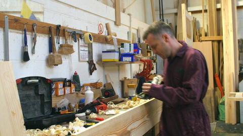 Carpenter Planing Wood In Workshop Footage