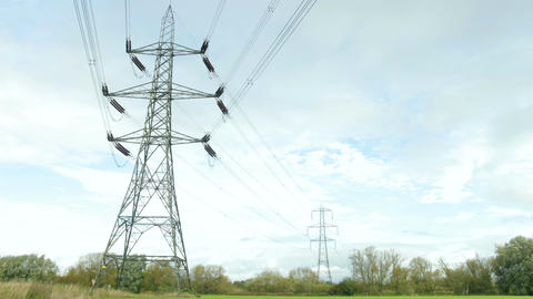 Time Lapse Sequence Of Electricity Pylons In Countryside Footage