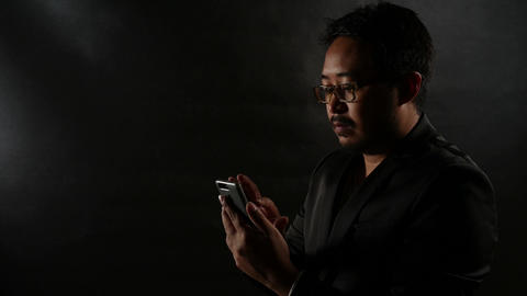 Businessman man using smartphone Browsing and Text Messaging ビデオ